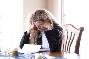 Woman Fretting Over Debt