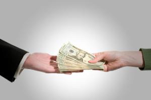 Handing-Over-Cash